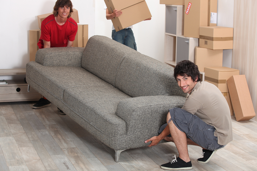 Moving and storage of furniture photo of 2 men lifting a couch
